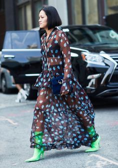 MyTheresa's buyer, Tiffany Hsu, is one of the biggest trendsetters in the fashion week street style circuit. Click here to see and shop her best looks.