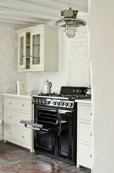 The panelled doors, with their pleasingly chunky handles, give more than a nod to the clean, austere lines of Shaker style but somehow manage to convey glamour at the same time. Full details on Modern Country Style blog: Modern Country Loves: Smeg Victoria Range Cooker