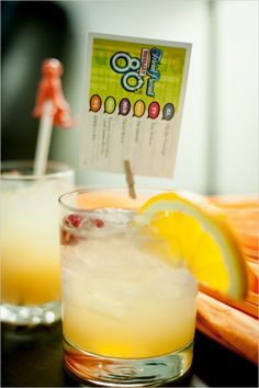 Signature wedding drink with cocktail trivia clothes-pinned to it. #weddingdrink #drinktrivia #weddingchicks Captured By: Vis-a-Vis Photography ---> http://www.weddingchicks.com/2014/05/01/go-craft-crazy-with-this-diy-wedding/