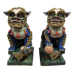 Chinese Ceramic Foo Dogs early 20th century, with Fusan Stamp in back. The dogs seperate from the stands which makes 4 pieces. Beautifuly hand crafted with excellent details