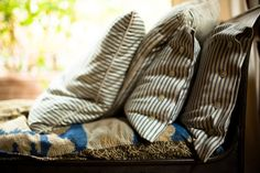 Pillows made of genuine vintage ticking Ticking Fabric, Ticking Stripe, Fabric Sofa, A Well Traveled Woman, Lakeside Cottage, Feather Pillows, Cozy Corner, Rustic Outdoor, Cabins In The Woods