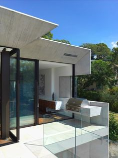 This modern house has sliding glass doors off the dining room that can be opened to a balcony with a built-in barbecue.