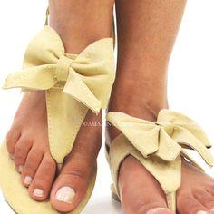 nude bow flip flops