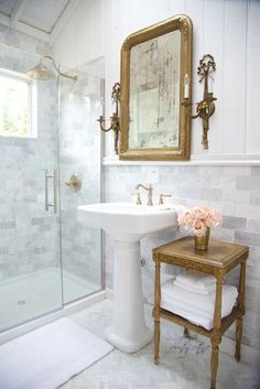 Traditional bathroom with accent table next to a pedestal sink Design Decor French Country Cottage @Lamps Plus