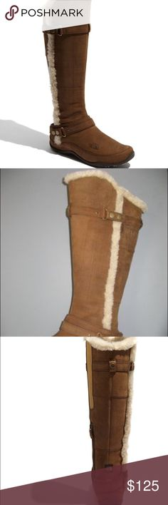 """The North Face Brianna' Boot Cozy faux fur trims a slender, waterproof boot with 200 grams of PrimaLoft® insulation and recycled fleece lining to keep feet warm. Durable TNF Winter Grip™ rubber sole features IcePick™ lugs for ground-grabbing traction in any weather. Approx. boot shaft height: 17""""; 16"""" calf circumference. Wide calf. Leather upper/recycled P.E.T. fleece lining/rubber sole. By The North Face The North Face Shoes Winter & Rain Boots"""