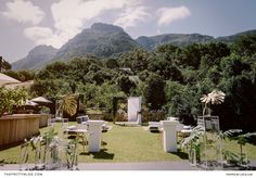 The gardens of Maison Noir Villa, based in the Cape Town suburb of Hout Bay, formed a scenic location for a modern wedding ceremony and pre-drinks gathering. | Photographer: Lad & Lass | Coordinator: Wedding Concepts | Florist: Opus Studio