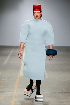 I guess this is the housework costume of the future?  Scrubbies on feet, check;  full-body dust-cloth?  check.  I can only imagine the headwear is a container for soap and/or furniture polish.  [PHOTO © TEAM PETER STIGTER   FILENAME IS DESIGNER NAME  FASHIONCLASH 2014]
