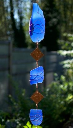 This wind chime is made completely out of glass and copper (and a beach stone clapper / striker). It is extremely well suited for year round outdoor use in all climates. It is made to last. This beaut