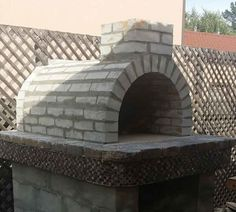 A combination of Concrete, Brick, Pavers & Tile make one of the most beautiful Mattone Barile Grande ovens in California Wine Country!  To see more pictures of this oven (and many more ovens), please visit - BrickWoodOvens.com