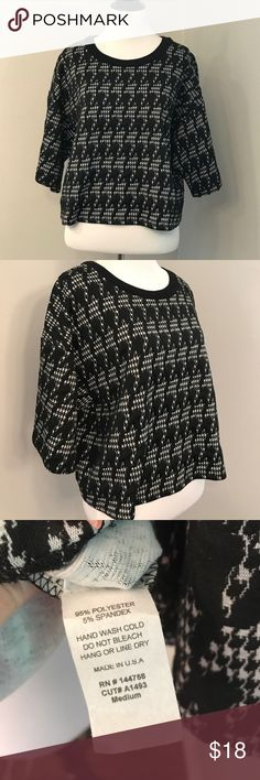 Houndstooth blouse This is a super cute houndstooth sweater type crop blouse. It's not super short (so not exactly a crop) but not as long as a tee. Lime and Chili Tops Blouses