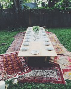 Bring your picnic to the next level—dine on colorful Moroccan rugs on the comfort of your grass.