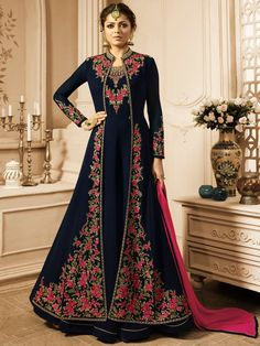 Drashti dhami navy blue designer jacket style suit online which is crafted from georgette fabric with exclusive embroidery and hand work. This stunning designer jacket style suit comes with santoon bottom and chiffon dupatta. Abaya Fashion, Indian Fashion, Fashion Dresses, Designer Anarkali, Indian Gowns Dresses, Indian Outfits, Abaya Mode, Party Wear Long Gowns, Dress Party