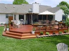 Wood Deck Design Ideas.. I like the wide stairs and the railing design. plus it's the perfect size