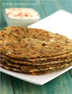 Healthful moong dal takes the form of a tasteful paratha here! cooked moong dal, along with potato for binding, onions for crunch and a range of spices for added flavour, makes a great stuffing for parathas that are crisp outside and soft inside. You will enjoy the unique combination of spices in this paratha, especially the thoughtful addition of crushed coriander seeds and amchur.