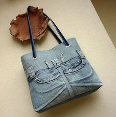 Denim handbag with pockets and belt loops - translate page - inspiration only this is for sale.