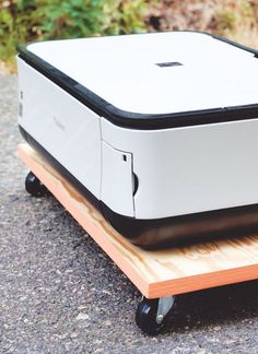 Love the idea of freeing up a huge chunk of your desk being taken up by a giant printer? Make this rad DIY painted-edge printer tray spotted on Jade and Fern and roll that puppy in and out of your office area when you need it.
