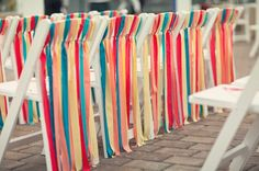 Decorate folding chairs with ribbon or streamers