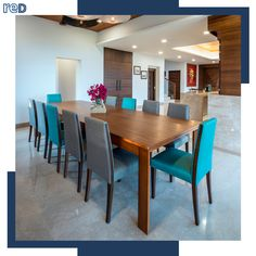 Indigo blue and grey chairs add a dash of color to a minimalistic dining room set up. High Ceiling Decorating, Decorating Small Spaces, Decorating Ideas, French Cafe Decor, Home Interior Design, Interior Architecture, Florida Home Decorating, Stair Landing Decor, Dining Area