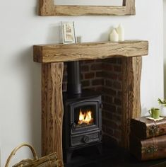 The Aged oak fire surround is styled from large solid oak beams with deep waney edges. The aged beam is hand sanded smooth on all edges before flaming the grain and hand finishing with a clear wax. Home, Living Room With Fireplace, Wood Fireplace, Oak Beam Fireplace, Wood Fireplace Surrounds, Oak Fire Surround, Fireplace Decor, Cottage Living Rooms, Cosy Living Room