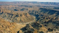 10 Most Famous Natural Landmarks In Africa Most Famous Natural Landmarks In Africa: Fish River Canyon, Namibia (source wiki) Land Of The Brave, Safari, Formations Rocheuses, Visiting The Grand Canyon, Namibia, Parcs, Most Visited, Best Location, Africa Travel