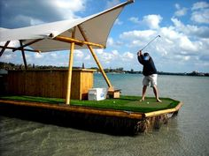 Pontoon Boat with a Tiki and a Putting Green #wantone