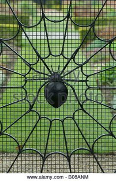 Stock Photo - Detail of a painted iron gate in Portmeirion Village spiders web on wrought iron gate Spider Art, Window Grill Design, Sculpture Metal, Gothic Garden, Metal Yard Art, Gothic Furniture, Wrought Iron Gates, Steel Art, Welding Art