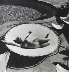 Andre De Dienes - Marilyn Monroe lying naked on a trampoline, 1953.