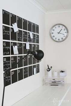 Chalkboard calendar. i would use magnetized chalkboard paint and make the numbers magnets, because that would save me 3.278594 minutes.