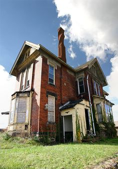 This long abandoned home in Salem, Ohio was built in 1884 and has the most unique chimney I have ever seen. Such a character!