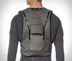 Adidas have released an awesome low-profile vest backpack as part of their new Yohji Yamamoto Y-3 line. The Y-3 Sport Backpack is perfect for carrying your essentials without the need for a heavy cumbersome backpack hanging off your shoulders, it fit
