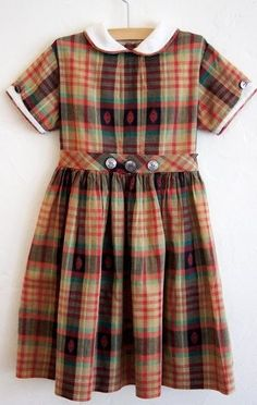 Girls were not allowed to wear pants when I was in school.  Dresses like these were the rule. I had to wear a snow suit in winter when I walked to school because my legs would get so cold.