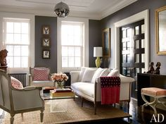 Contemporary Living Room by David Flint Wood and MADE in New York, New York - A trio of paintings by Hunt Slonem and pillows of a graphic John Robshaw linen accent Brooke Shields's Manhattan living room; the settee is George III, the curule-form stool is covered in a David Hicks fabric from Lee Jofa, and the jute rug is by Pottery Barn.