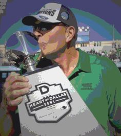 Coach Dan McCarney kisses the Heart of Dallas Bowl Trophy after the Mean Green won 36-14 against UNLV.