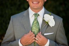 Green tie and grey suit. perfect for the daytime cocktail style.