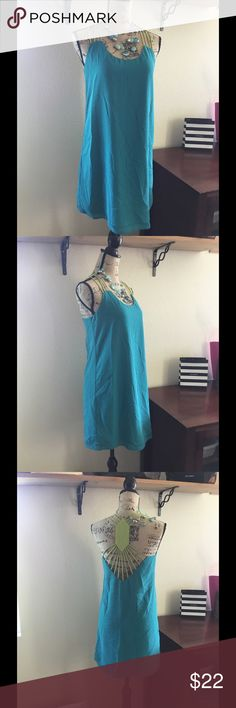 Great little blue boutique dress Great teal blue slip dress with fantastic mint green back.  55% cotton-45% polyester Dresses Mini