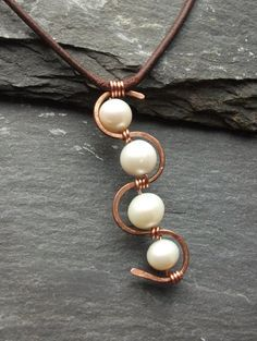 Leather Freshwater Pearls And Copper Necklace https://www.etsy.com/listing/120452630/leather-freshwater-pearls-and-copper?share_id=15086701&hmac=435efc670a6538f360908bf045a0fb499b5dc7c9
