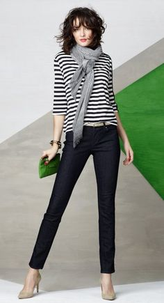 Ann Taylor ~ I would wear boot cut jeans.  Skinny jeans only work if you are a size 2.  Trust me - 10 years from now, you will see a picture of yourself in skinny jeans and then destroy said picture.  :)