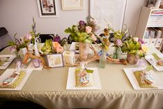 """Since I am a florist, of course the flowers were one of my favorite parts of the shower,"" Kristen says. ""My staff helped make each table really feel like the author's literature was coming to life. The Beatrix Potter table featured kale, branches, and soft colors that were a nod to her watercolor illustrations."" Source: Kio Kreations"