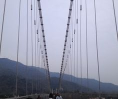 It is said that this iron suspension bridge was built in place of a jute rope which Lakshmana had used to cross the Ganga. A couple of kilometres ahead the downstream is another bridge called Ram Jhula. The stretch of these two bridges gives an incredible view of Rishikesh !