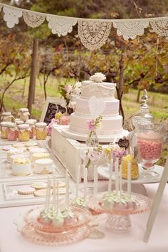 shabby chic wedding cake / dessert table with lace & vintage cake plates