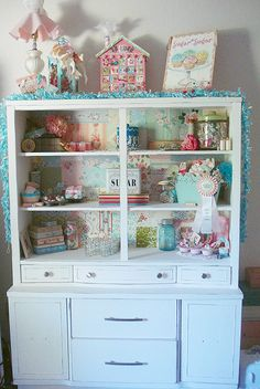 Sweet shelves - backboard lined with assorted vintage wallpaper