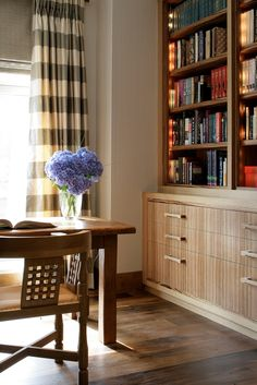 Study featuring custom designed bookcases with drawers to hold the client's extensive library