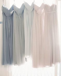 We love this array of soft pastel bridesmaids gowns! Photo via Meet Dresses