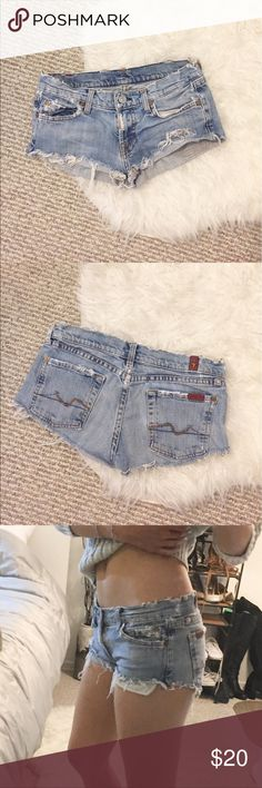 Distressed Super short denim shorts Extremely distressed. I usually wear a size 24, and this is pretty tight on me. Size states 26, but this would definitely fit a size 23 better. Please let me know if you have any questions before purchasing. 😘 7 For All Mankind Shorts Jean Shorts