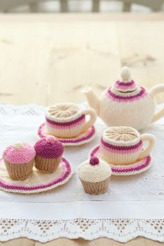 Knitted toy tea set with teapot, cup and saucer, plate and cupcake. Shop this knitting pattern now at The Knitting Network