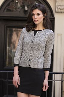 A vintage-inspired cardigan, modernized by sparkly metallic yarn, CELINE. The allover stitch pattern utilizes the floats created by slipped stitches to create a textured pattern.
