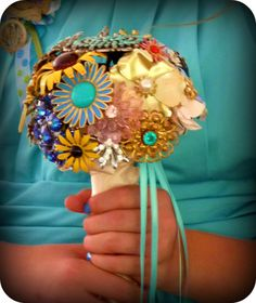the vintage flower brooch bouquet that Oliveloaf designs creator made for her wedding