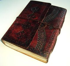 Leather bound journal. I would kill to have this as my guest book/wedding album scrap book!!!!