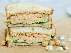 This Buffalo Chickpea Salad Sandwich recipe is light and creamy--a perfect vegetarian lunch that takes less than 10 minutes to prepare!