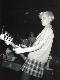 Kathi Wilcox (Bikini kill). Love grunged up preppy staples. Adore her hair.